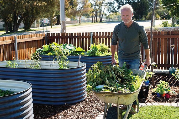 Man in the garden with a wheelbarrow