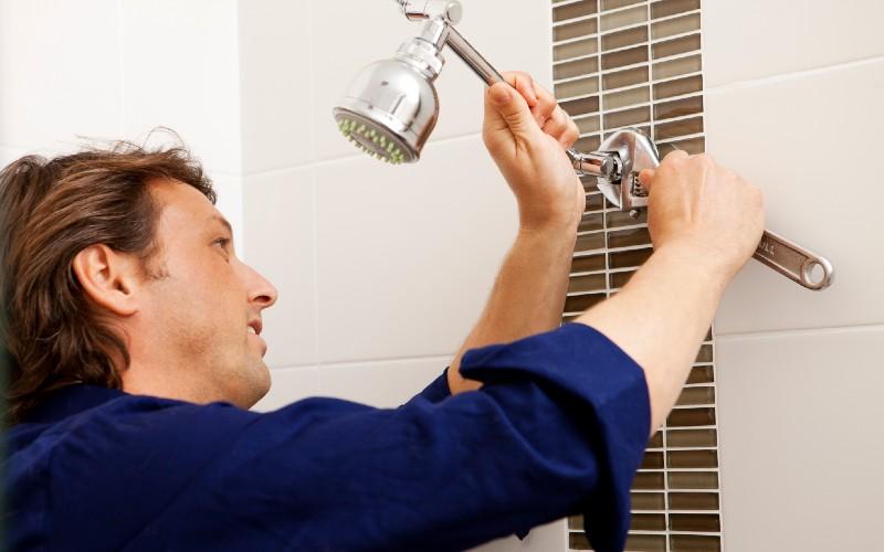 Plumber installing a waterwise showerhead