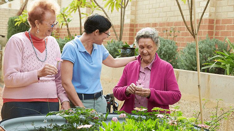Residents enjoying native garden at Southern Cross Care.
